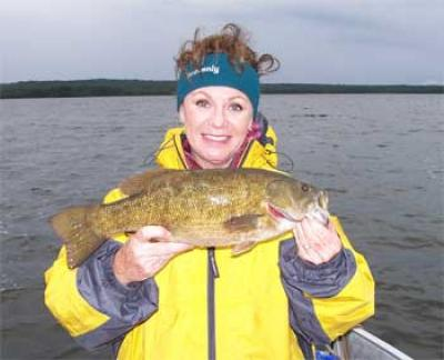 ladies fishing smallmouth bass at canada lodges
