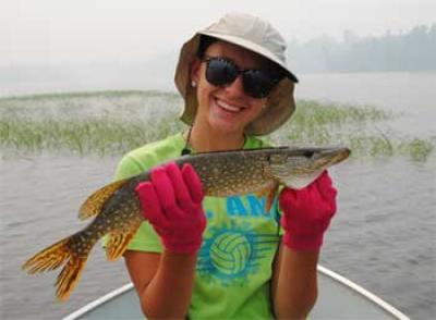 father & daughter fishing northern pike in Canada
