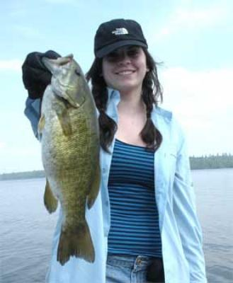 young ladies fishing for trophy smallmouth bass in Canada
