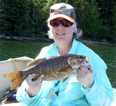 ladies trophy smallmouth bass catch in Canada