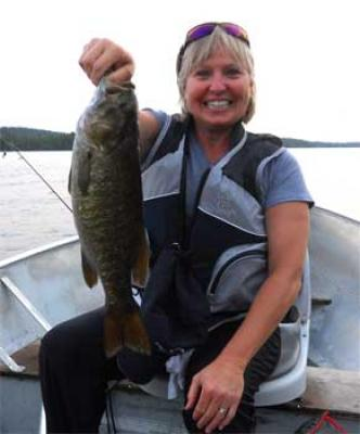 Women Trophy Fishing for Smallmouth Bass at Canada Lodges