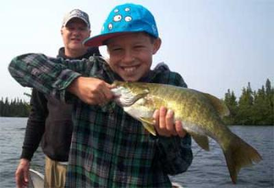 BIG Smallmouth Bass by Father and Son Fishing Canada