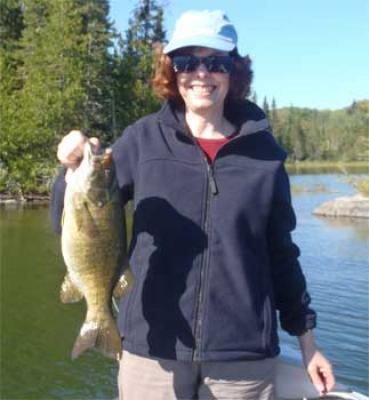 Women Fishing Trophy Smallmouth Bass at Fireside Lodge Canada