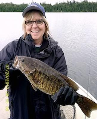 Ladies Fishing at Fireside Lodge for Trophy Smallmouth Bass by Jill