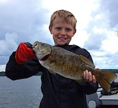19.5 inch Smallmouth Bass Trophy Fishing by Tommy at Fireside Lodge Canada