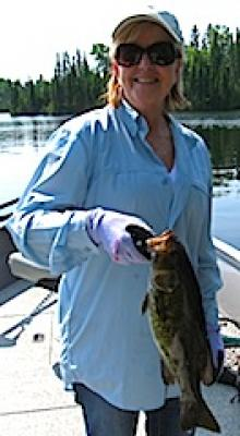 Lady Smallmouth Bass Fishing at Fireside Lodge in Canada