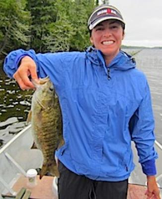 Lady Angler Fishing for Smallmouth Bass at Fireside Lodge in Canada