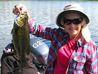 Ladies catching Trophy Smallmouth Bass Fishing in Canada