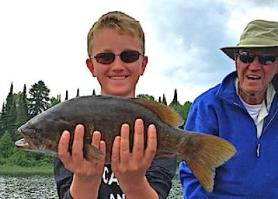Grandpa Grandson Trophy Smallmouth Fishing at Fireside Lodge in Canada