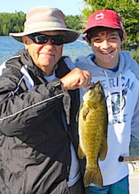 Grandpa Smallmouth Bass Fishing with Grandson at Fireside Lodge in Canada