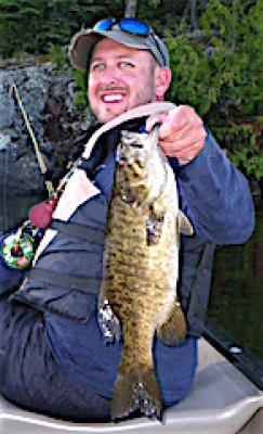 BIG Smile BIG Trophy Smallmouth Bass Fishing at Fireside Lodge in Canada