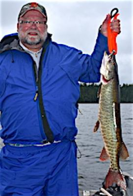 Proud First Muskie Fishing at Fireside Lodge in Canada