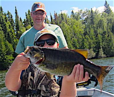 First Trophy Smallmouth Bass with Grandpa Fishing at Fireside Lodge in Canada