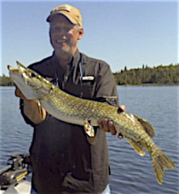 Friends Fishing Northern Pike at Fireside Lodge in Canada