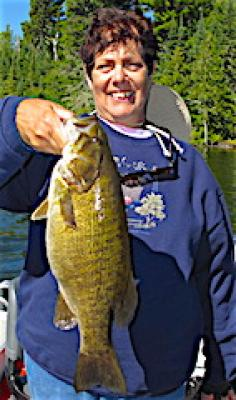 Lady Trophy Smallmouth Bass Fishing at Fireside Lodge in Canada