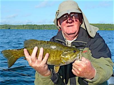 Fishing Trophy Smallmouth Bass on Rocks at Fireside Lodge in Canada