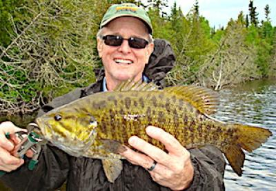 Barred Trophy Smallmouth Bass Fly Fishing at Fireside Lodge in Canada