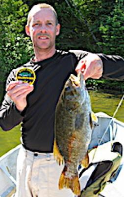 Monsterous Trophy Smallmouth Bass Fishing at Fireside Lodge in Canada