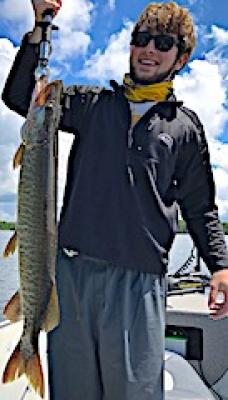 Great 1st Muskie Catch at 33-Inches Fishing at Fireside Lodge in Canada