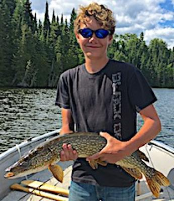ather Son Fun Fishing Northern Pike at Fireside Lodge in Canada