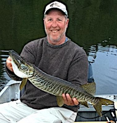 Smile Tells The Story Muskie Fishing at Fireside Lodge in Canada