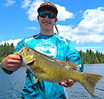 Happy Face Trophy Smallmouth Bass Fishing at Fireside Lodge in Canada