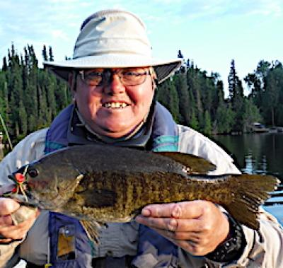 Big Smallmouth Bass On Surface Fly Fishing at Fireside Lodge in Canada