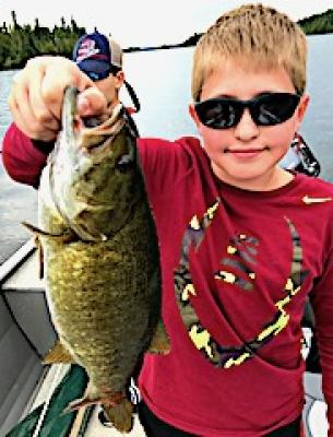 Kids Trophy Smallmouth Bass Fishing at Fireside Lodge in Canada