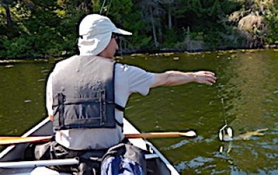Fishing Northern Pike in a Canoe at Fireside Lodge in Canada