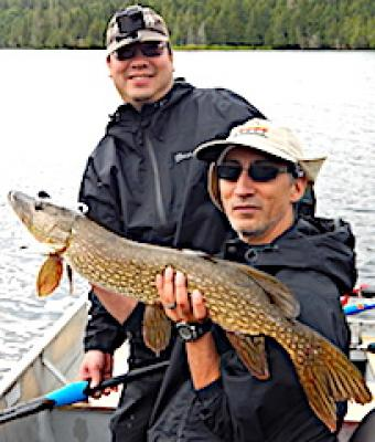 Brother Big Northern Pike Team Fishing at Fireside Lodge in Canada