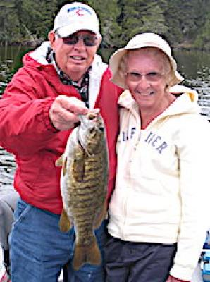 Husband Wife Trophy Smallmouth Bass Fishing at Fireside Lodge in Canada