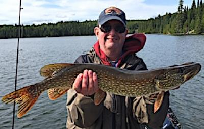 Satisfied Northern Pike Catch Fishing at Fireside Lodge in Canada