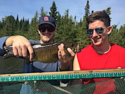 Measured Trophy Smallmouth Bass Fishing at Fireside Lodge in Canada