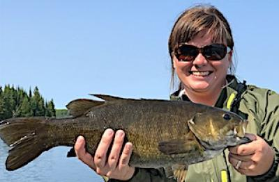 Girl On Fire Trophy Smallmouth Bass Fishing at Fireside Lodge in Canada