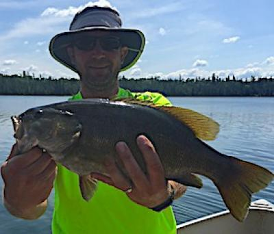 Here's a Trophy Smallmouth Bass Fishing at Fireside Lodge in Ontario Canada