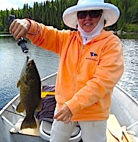Ladies Fishing Fireside Lodge for BIG Smallmouth Bass by Kathe Bernel