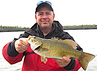Spring Smallmouth Bass Fishing at Fireside Lodge by Greg