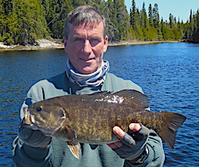 One of Many Trophy Smallmouth Bass Fishing by Frank at Fireside Lodge Canada