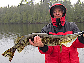 Super Early Spring Fishing for Northern Pike  at Fireside Lodge in Canada by Greg Foley