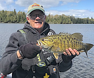 Beautiful Barred Trophy Smallmouth Bass Fishing by Paul at Fireside Lodge