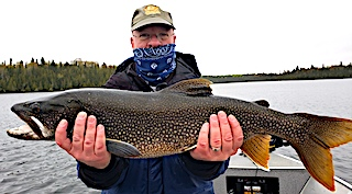 Nick with a Nice BIG Lake Trout Fishing at Fireside Lodge