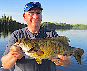 Trophy Smallmouth Bass Fishing At Fireside Lodge in Canada by Greg Foley