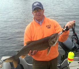 Big Lake Trout Fishing by Chris Grimes in Canada