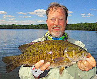 Super BIG Trophy Smallmouth Bass Fishing by Dan at Fireside Lodge in Canada