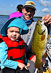 Joe Fishing Trophy Smallmouth Bass with Dad