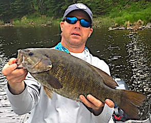 Mega Monster Trophy Smallmouth Bass Fishing at Fireside Lodge in Canada by Jason