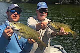 Big Smallmouth Bass Doubles by Stu and Jason Fishing at Fireside Lodge in Canada
