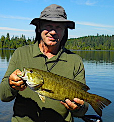 Many Trophy Smallmouth Bass Fishing by Steve at Fireside Lodge in Canada