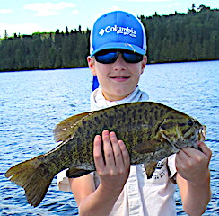 Tyler With His 1st Ever Trophy Smallmouth Bass Fishing at Fireside Lodge in Canada