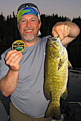 Fishing Trophy Smallmouth Bass at Dusk by Dan